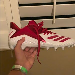 Red and white adidas foot ball cleats